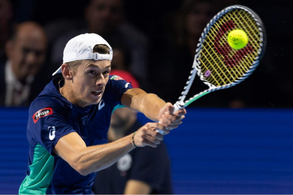 Australia's Alex De Minaur returns a ball to Switzerland's Roger Federer during their final match at the Swiss Indoors tennis tournament at the St. Jakobshalle in Basel, Switzerland, on Sunday Oct. 27, 2019. (KEYSTONE/Georgios Kefalas)