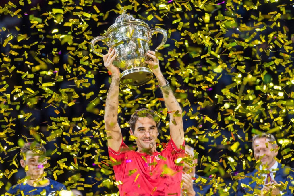 Switzerland's Roger Federer cheers after winning his tenth title at the Swiss Indoors tennis tournament at the St. Jakobshalle in Basel, Switzerland, on Sunday Oct. 27, 2019. (Georgios Kefalas/Keystone via AP)
