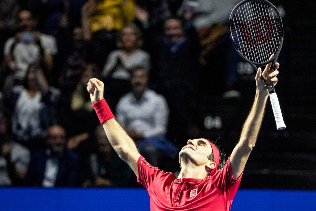 Roger Federer of Switzerland celebrates after defeating Alex De Minaur of Australia during their final match at the Swiss Indoors tennis tournament at the St. Jakobshalle in Basel, Switzerland, on Sunday, Oct. 27, 2019. (Alexandra Wey/Keystone via AP)