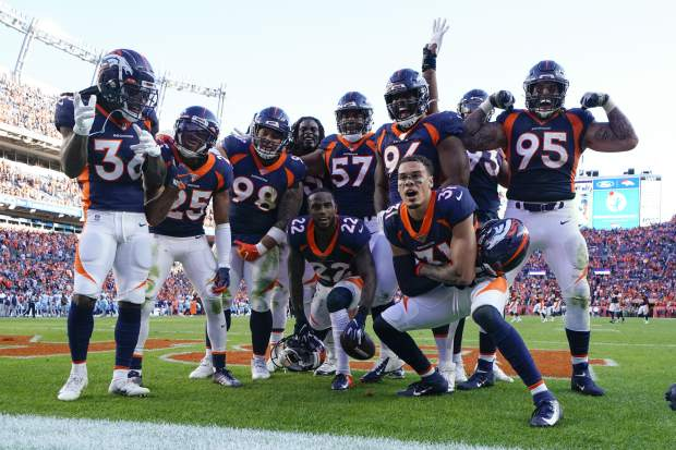 Denver Broncos defensive back Kareem Jackson (22) reacts with teammates after intercepting a pass during the second half of an NFL football game against the Tennessee Titans, Sunday, Oct. 13, 2019, in Denver. (AP Photo/Jack Dempsey)