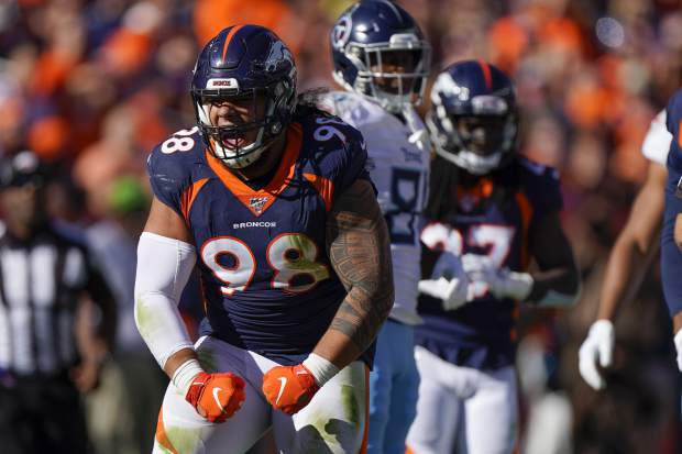 Denver Broncos nose tackle Mike Purcell (98) reacts after a stop against the Tennessee Titans during the first half of an NFL football game Sunday, Oct. 13, 2019, in Denver. (AP Photo/Jack Dempsey)