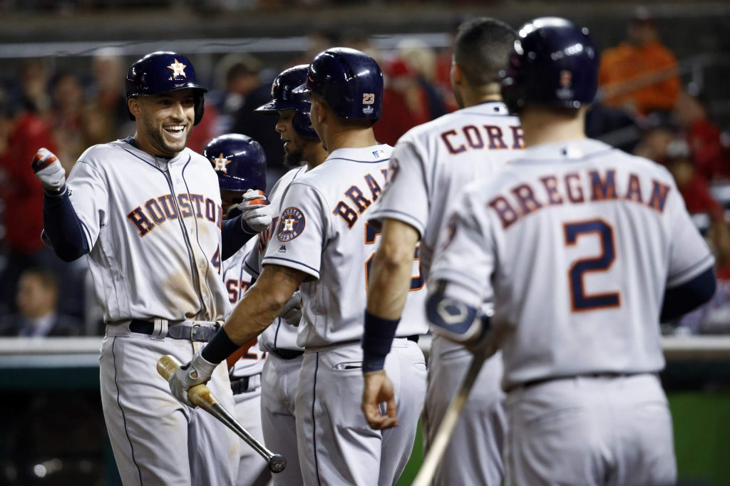 Houston Astros' George Springer celebrates after a two-run home run against the Washington Nationals during the ninth inning of Game 5 of the baseball World Series Sunday, Oct. 27, 2019, in Washington. (AP Photo/Patrick Semansky)