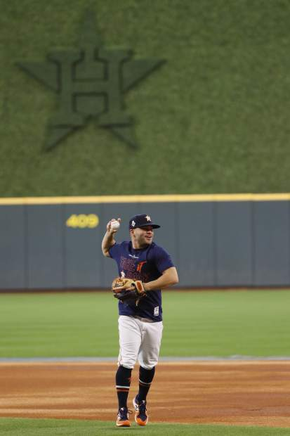 Houston Astros second baseman Jose Altuve warms up during batting practice for baseball's World Series Monday, Oct. 21, 2019, in Houston. The Houston Astros face the Washington Nationals in Game 1 on Tuesday. (AP Photo/Matt Slocum)