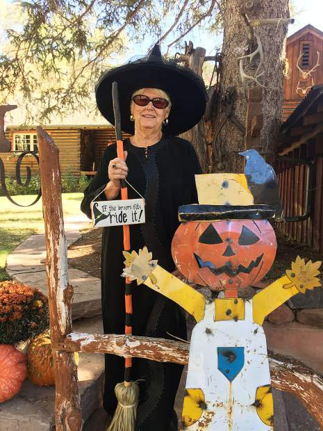 Mary Ann Taylor, resident witch, with pumpkin head