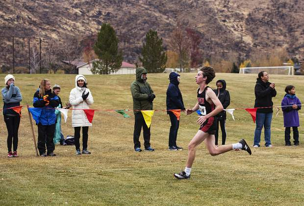 Aspen High School's Brenon Reed runs to the finish line while competing in the regional meet at Crown Mountain Park in El Jebel on Friday, October 18, 2019. (Kelsey Brunner/The Aspen Times)