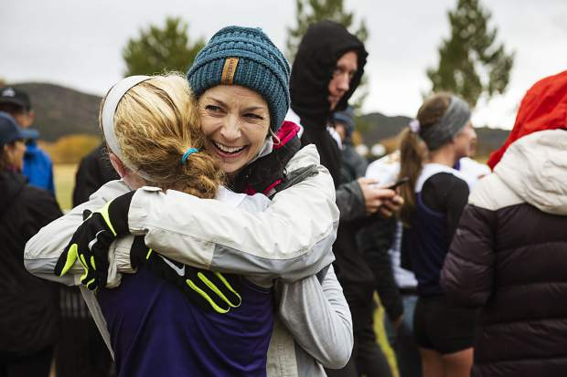 Jacy Allen, right, hugs Basalt's varsity cross country athlete Sarah Levy after her regional race at Crown Mountain Park in El Jebel on Friday, October 18, 2019. Allen's son, Noah Allen competed in the varsity boys meet, and she wanted to give Levy a hug after the race. (Kelsey Brunner/The Aspen Times)