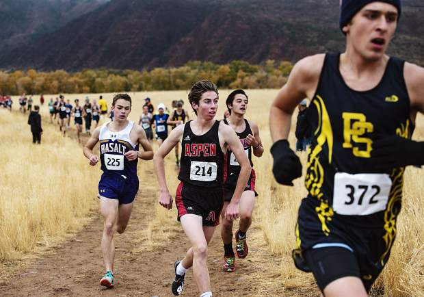 Varsity boys cross country athletes turn a corner on the regional course at Crown Mountain Park in El Jebel on Friday, October 18, 2019. (Kelsey Brunner/The Aspen Times)