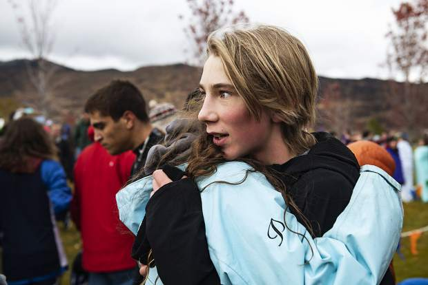 Aspen High School cross country athlete Eske Roennau receives a hug after competing in the regional meet at Crown Mountain Park in El Jebel on Friday, October 18, 2019. (Kelsey Brunner/The Aspen Times)