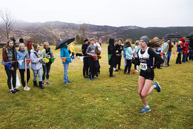 Basalt High School's Sierra Bower runs to the finish line while friends and family cheer her on during the 3A regionals at Crown Mountain Park in El Jebel on Friday, October 18, 2019. (Kelsey Brunner/The Aspen Times)