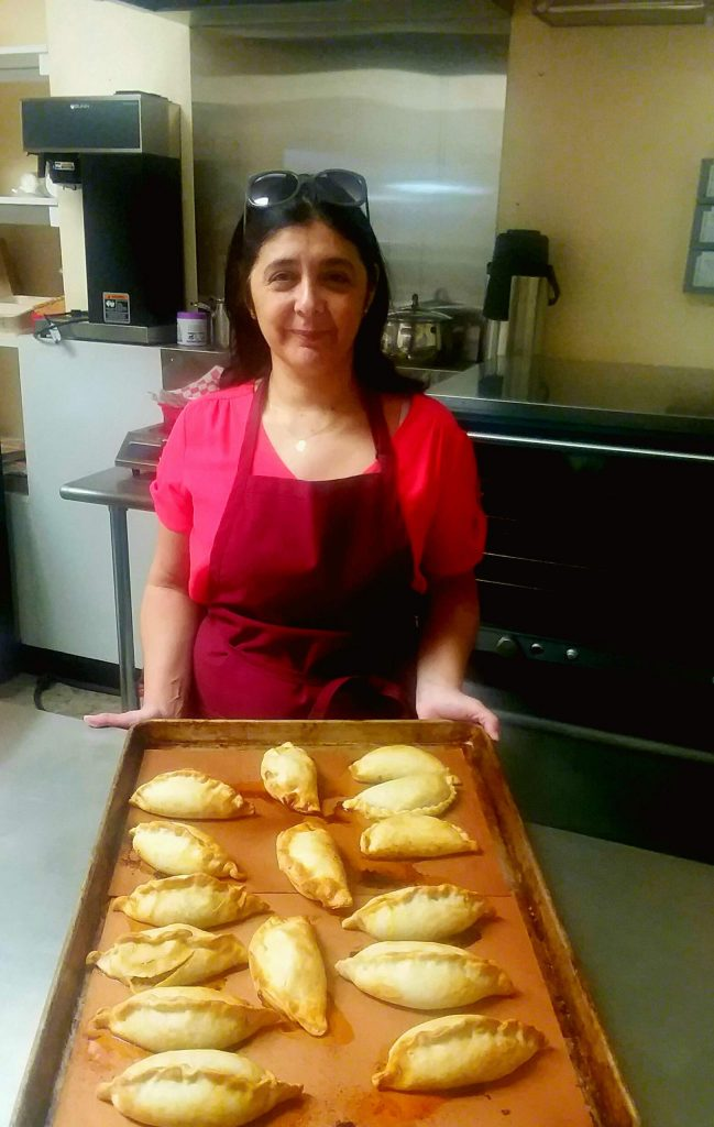 Fernanda Flesner displays some of her fare at Baires Empanadas.