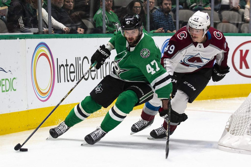 Dallas Stars right wing Alexander Radulov (47) skates with the pucks as Colorado Avalanche defenseman Samuel Girard (49) defends during the first period of an NHL hockey game in Dallas, Tuesday, Nov. 5, 2019. (AP Photo/Sam Hodde)