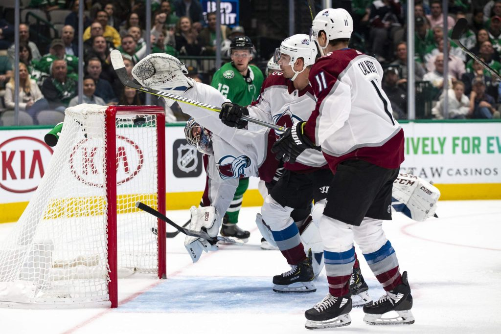 Colorado Avalanche goaltender Philipp Grubauer (31) attempt to block a shot during the first period of an NHL hockey game against the Dallas Stars in Dallas, Tuesday, Nov. 5, 2019. (AP Photo/Sam Hodde)