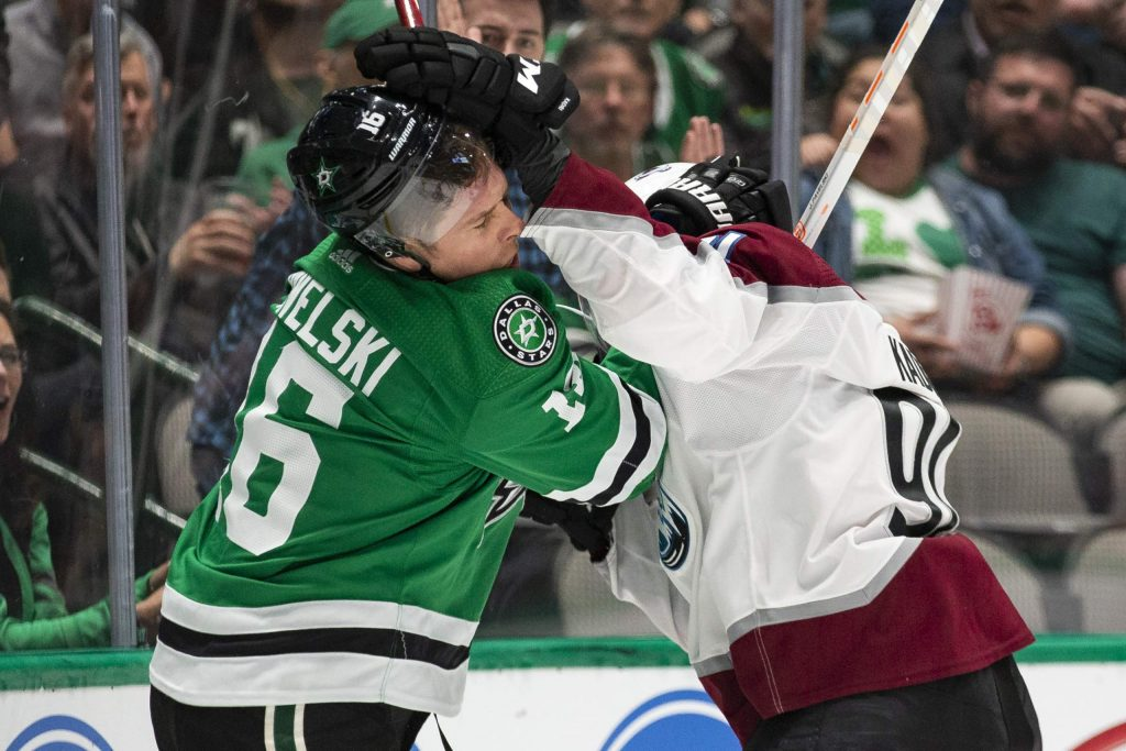 Dallas Stars center Joe Pavelski (16) is hit by Colorado Avalanche center Nazem Kadri (91) during the first period of an NHL hockey game in Dallas, Tuesday, Nov. 5, 2019. (AP Photo/Sam Hodde)