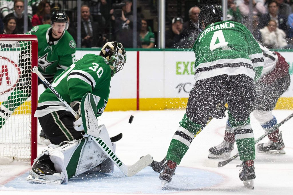 Dallas Stars goaltender Ben Bishop (30) blocks a shot during the second period of an NHL hockey game against the Colorado Avalanche in Dallas, Tuesday, Nov. 5, 2019. (AP Photo/Sam Hodde)
