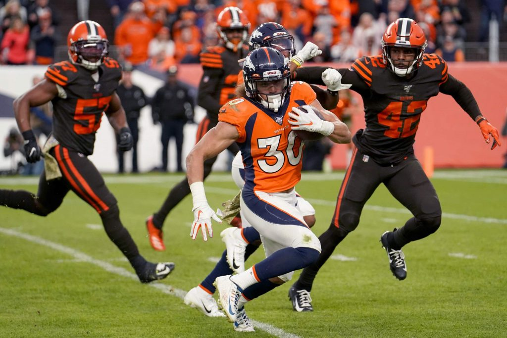 Denver Broncos running back Phillip Lindsay (30) runs for a 30-yard touchdown against the Cleveland Browns during the second half of NFL football game, Sunday, Nov. 3, 2019, in Denver. (AP Photo/Jack Dempsey)