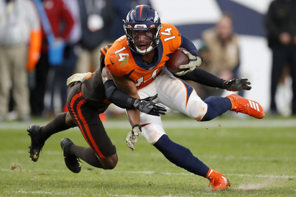 Denver Broncos wide receiver Courtland Sutton (14) is hit by Cleveland Browns cornerback Denzel Ward during the second half of NFL football game, Sunday, Nov. 3, 2019, in Denver. (AP Photo/David Zalubowski)