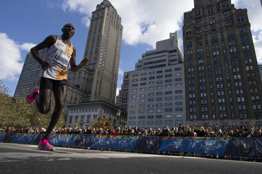 Geoffrey Kamworor, of Kenya, leads the professional men's division during the New York City Marathon, Sunday, Nov. 3, 2019, in New York. (AP Photo/Eduardo Munoz Alvarez)