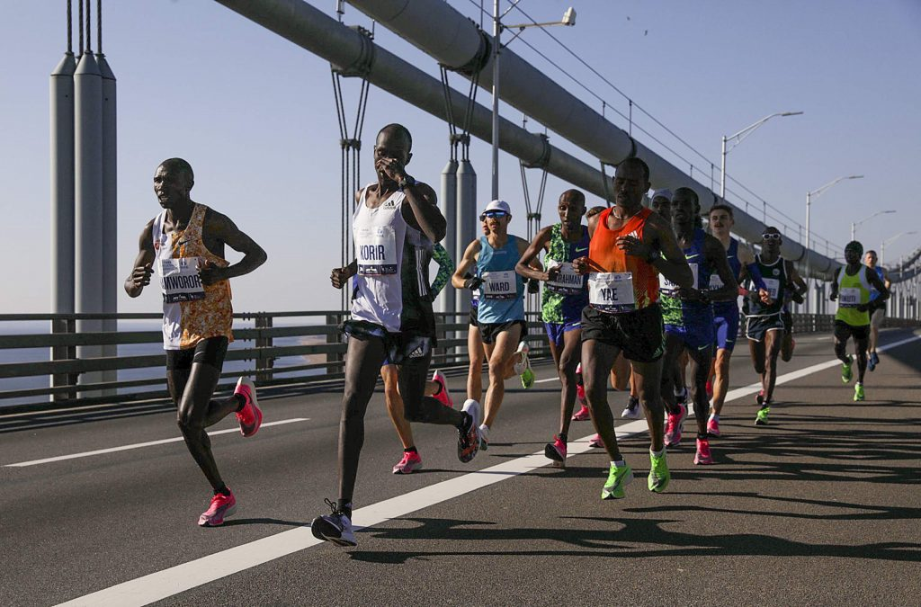 Runners in the men's elite division make their way across the Verrazano-Narrows Bridge during the New York City Marathon, Sunday, Nov. 3, 2019, in New York. (AP Photo/Julius Motal)