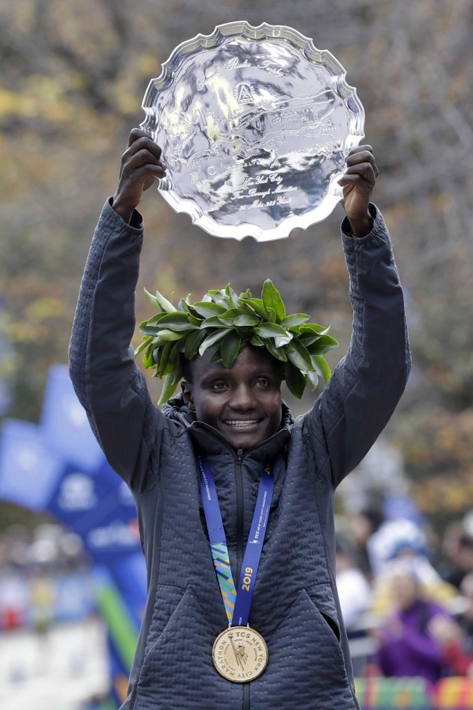 Joyciline Jepkosgei, of Kenya, poses for photos as the women's winner of the New York City Marathon, in New York's Central Park, Sunday, Nov. 3, 2019. (AP Photo/Richard Drew)
