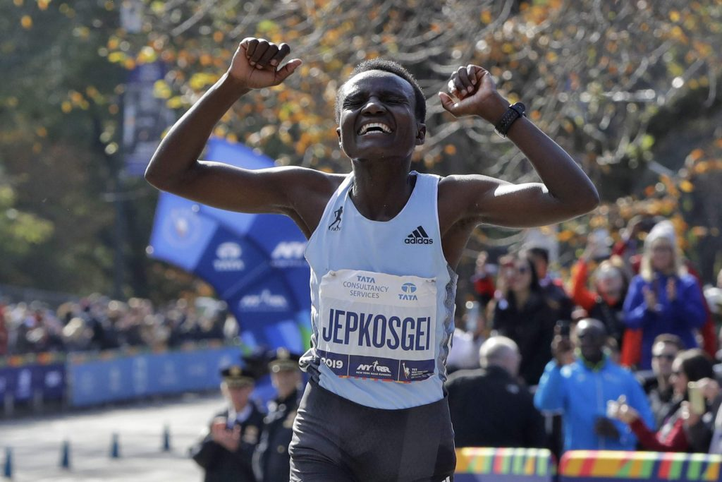 Joyciline Jepkosgei, of Kenya, celebrates after winning the Pro Women's Division of the New York City Marathon, in New York's Central Park, Sunday, Nov. 3, 2019. (AP Photo/Richard Drew)