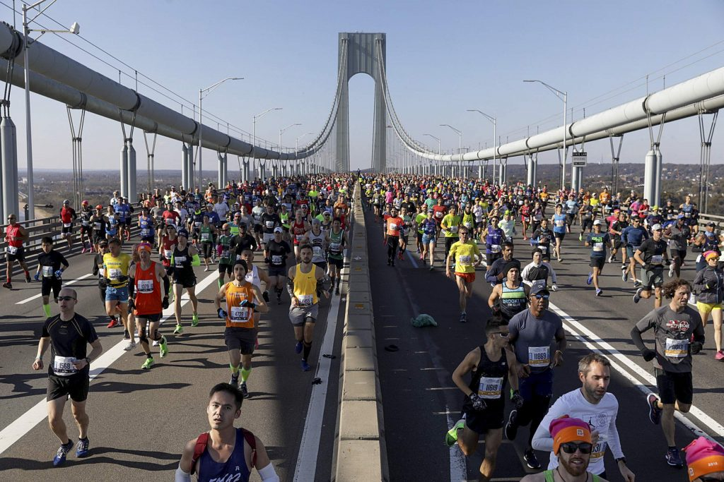 Runners make their way across the Verrazano-Narrows Bridge during the start of the New York City Marathon, Sunday, Nov. 3, 2019, in New York. (AP Photo/Julius Motal)