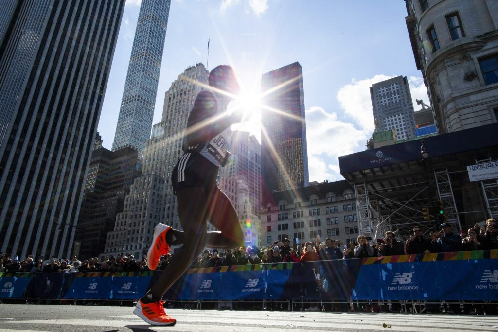 CORRECTS TO JOYCILINE NOT MARY Joyciline Jepkosgei of Kenya leads the professional women's division during the New York City Marathon, Sunday, Nov. 3, 2019, in New York. (AP Photo/Eduardo Munoz Alvarez)