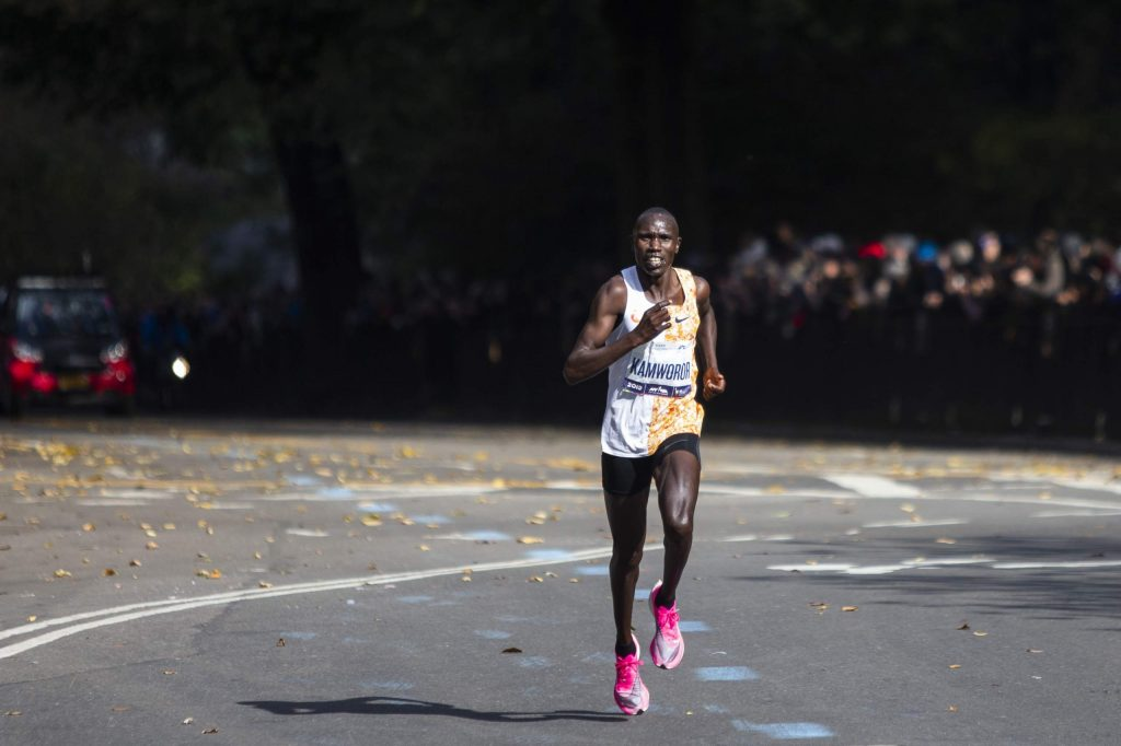 Geoffrey Kamworor of Kenya leads the professional men's division during the New York City Marathon, Sunday, Nov. 3, 2019, in New York. (AP Photo/Eduardo Munoz Alvarez)