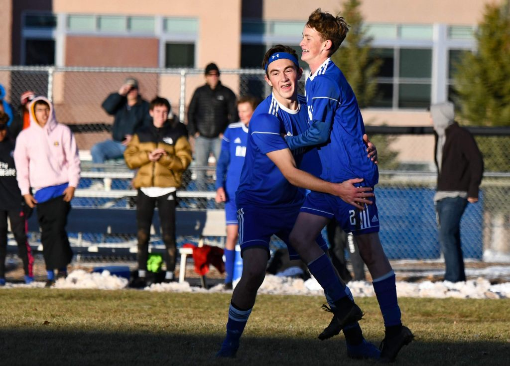 Roaring Fork Rams Ross Barlow and Lucas Schramer celebrate after a goal in the Rams' first-round playoff win over Peak to Peak earlier in November.