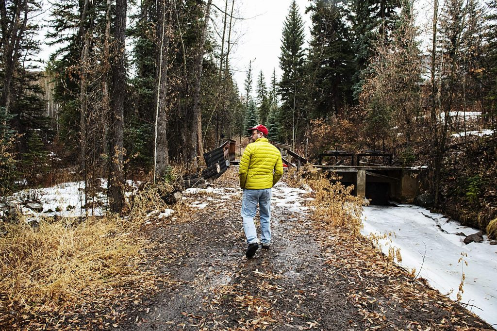 Eric Kaika walks down by Snowmass Creek on the property of the Aspen Camp of the Deaf and Hard of Hearing in Old Snowmass on Thursday, November 21, 2019. There are hiking paths and a fire pit that the campers can enjoy. (Kelsey Brunner/The Aspen Times)