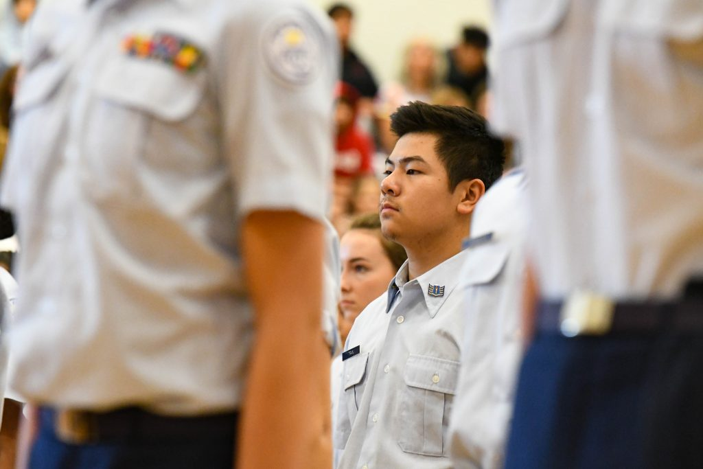 A member of the Glenwood Springs High School Airforce Junior ROTC stands during a presentation at the Veterans Day Assembly at the school on Monday.