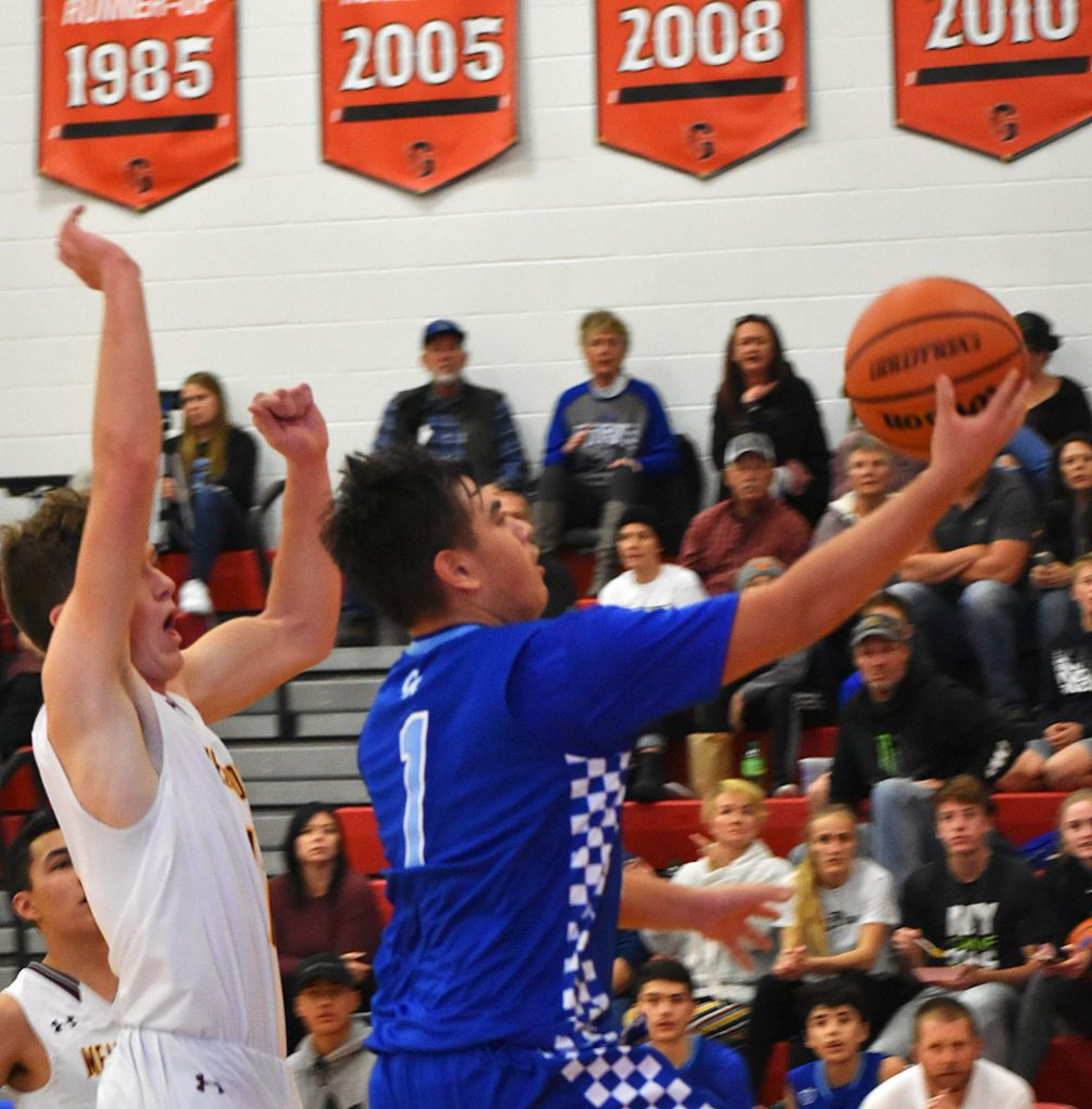 Coal Ridge junior Andrew Herrera goes for a layup Saturday in the Titans' 79-73 win over Alamosa to take third place in the Glenwood Demon Invitational at GSHS.