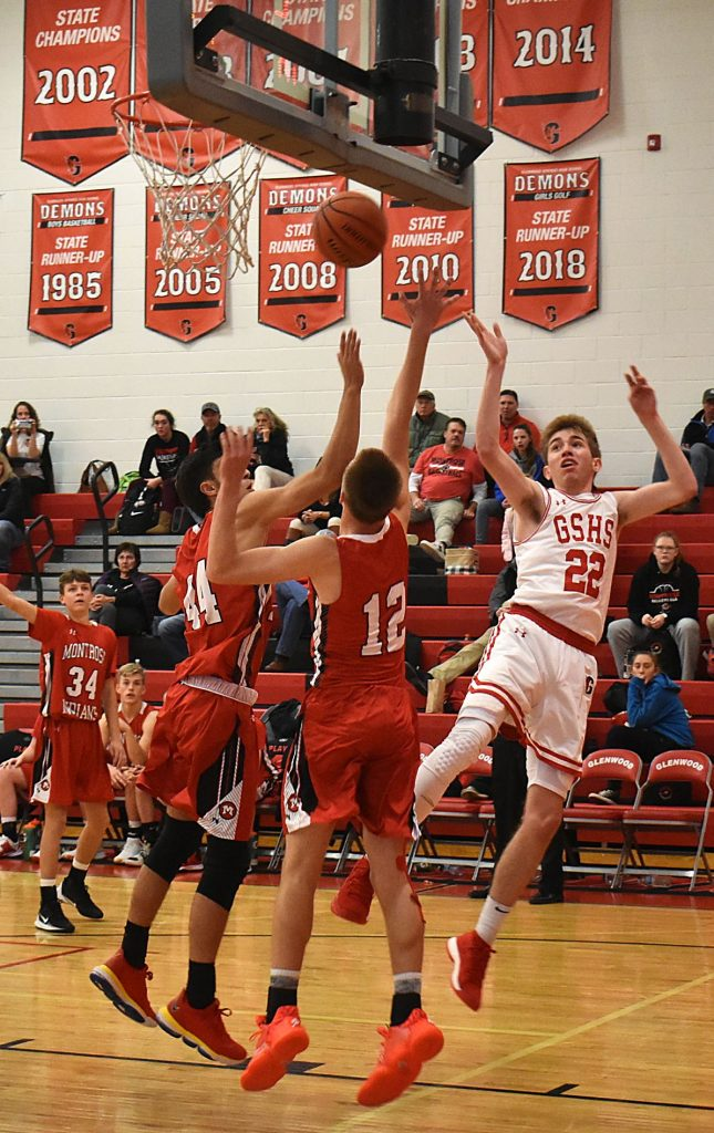 Glenwood Springs senior Will Narvaez shoots a fade-away shot over a pair of Montrose defenders earlier this season.