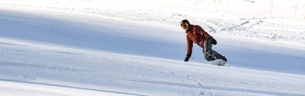 A snowboarder makes some turns down Midway run at Sunlight Mountain on opening day on Dec 6.
