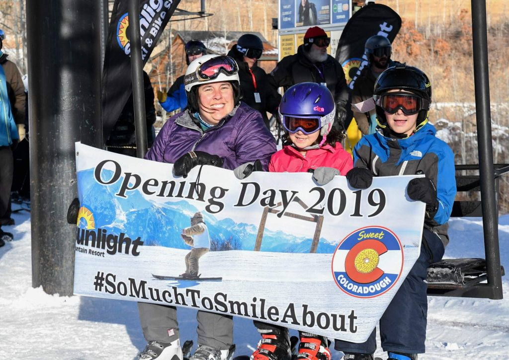 The first lift riders help to celebrate the opening of Sunlight Mountain Resort for the 2019-20 season on Dec. 6th.