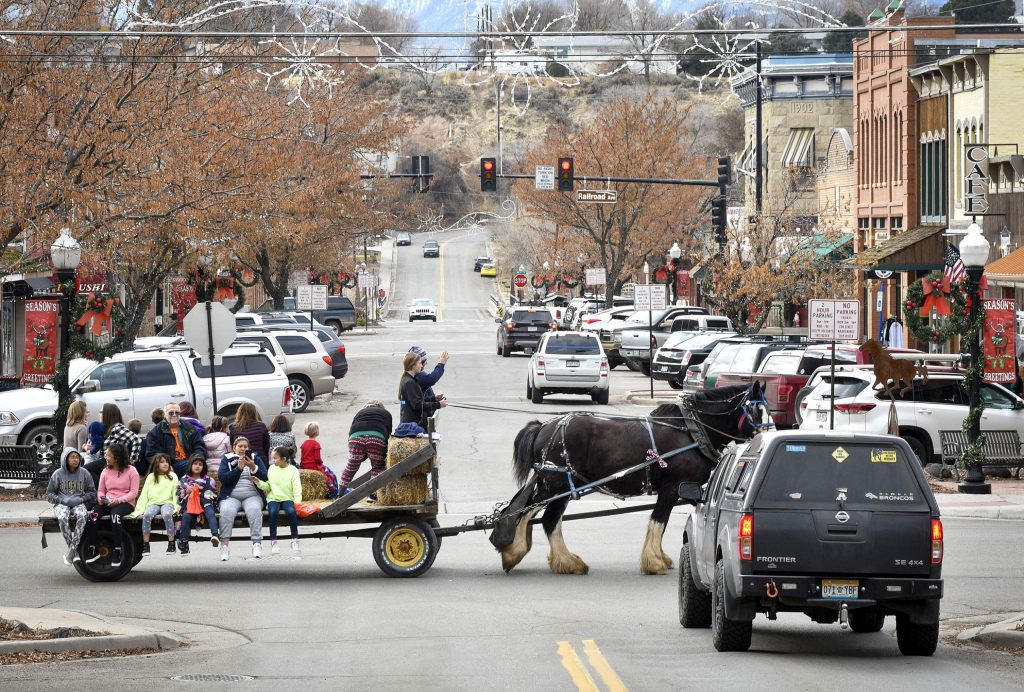 People take advantage of the horse drawn hay rides through downtown Rifle last Saturday.