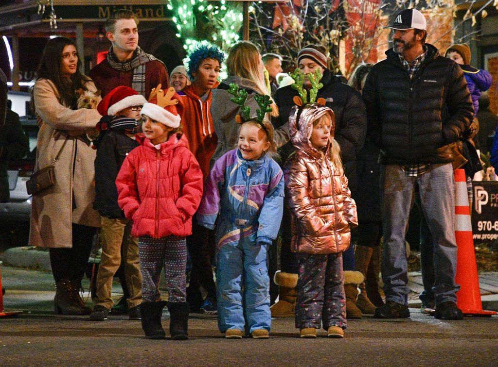 Families line Railroad Avenue to catch a glimpse of the annual Parade of Lights through downtown Rifle at part of Hometown Holiday last Saturday.