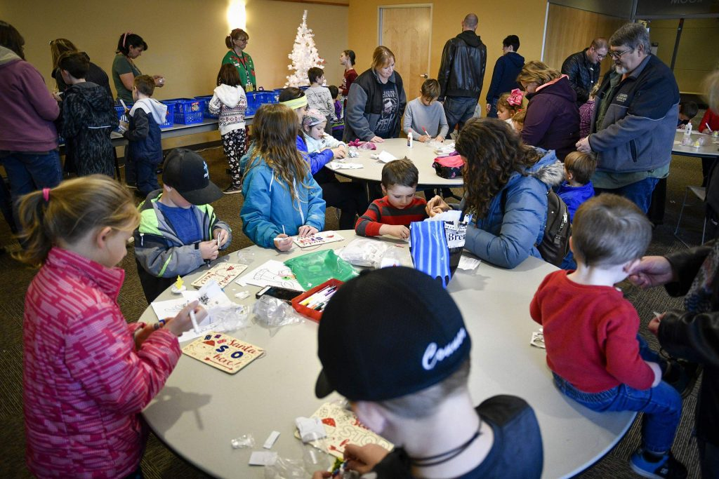 Families crowded in to the Rifle Library last Saturday during the ornament decorating class last Saturday as part og Hometown Holiday.