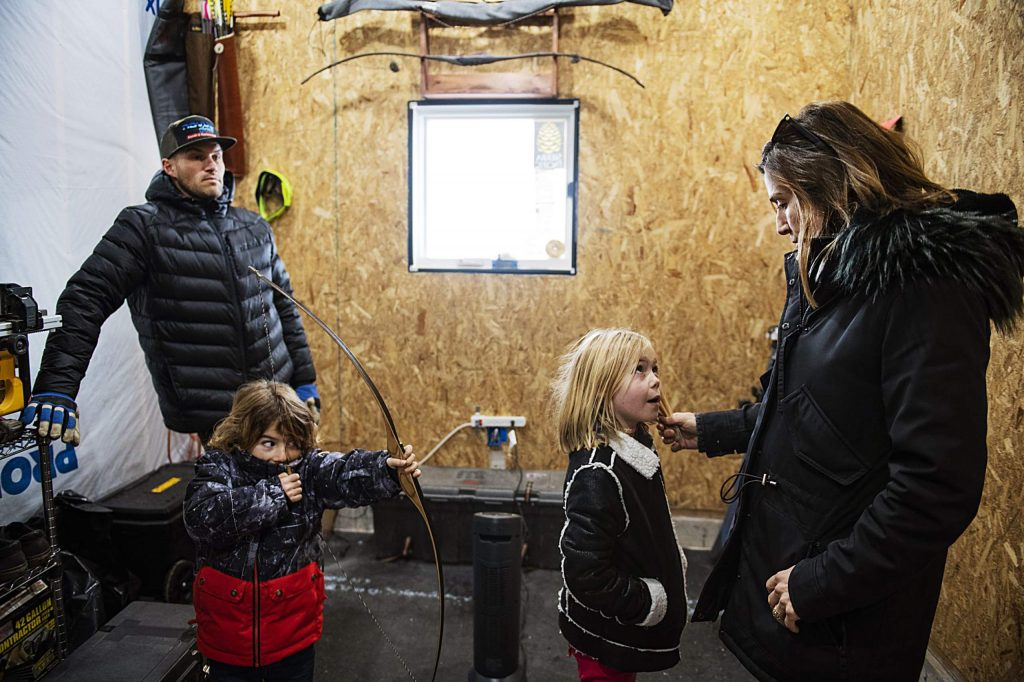 The family talks inside of one of the rooms in their under-construction structure where they have a heater set up on their property in Carbondale on Sunday, December 15, 2019. Most of Jake Zamansky's things were being stored in this room, because he was out of town during most of the time that the family was living in the RV.