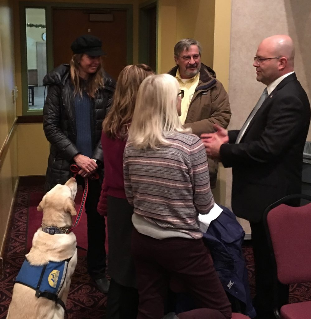 Joseph Deras, right, speaks to residents at a meet and greet with community members in Glenwood Springs earlier this month.