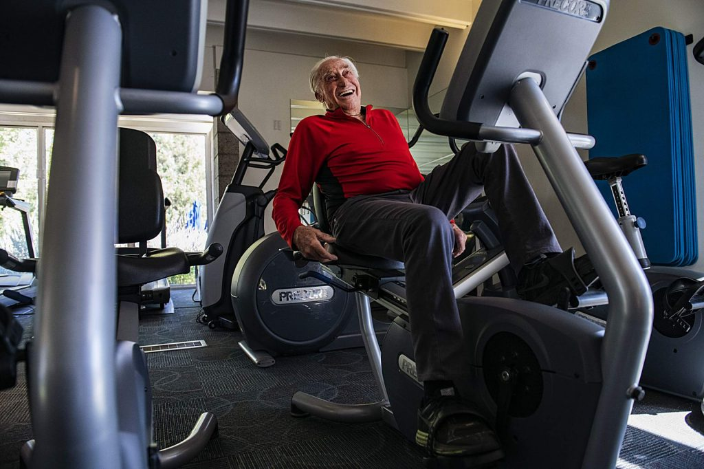 Klaus Obermeyer laughs while working out in September 2019.