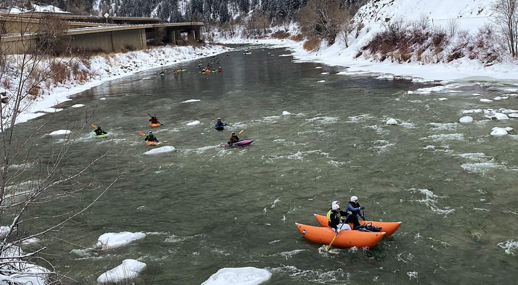More than 100 kayakers, whitewater rafters and stand-up paddleboarders braved icy conditions in Glenwood Canyon Tuesday to participate in a New Year's Day tradition dating back to the 1970s.