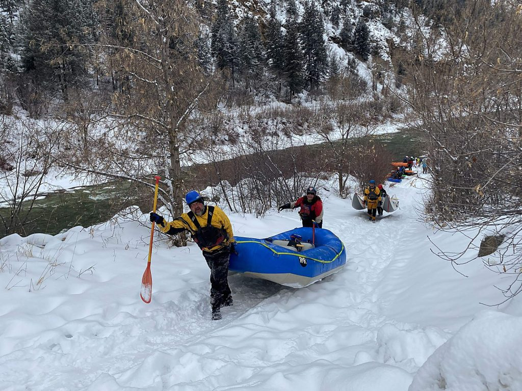 A pair of Glenwood area rafters exit the water after a successful run through the Shoshone rapids on Tuesday. The locals said they look forward to seeing boaters from all over the state join them each year in Glenwood Canyon.