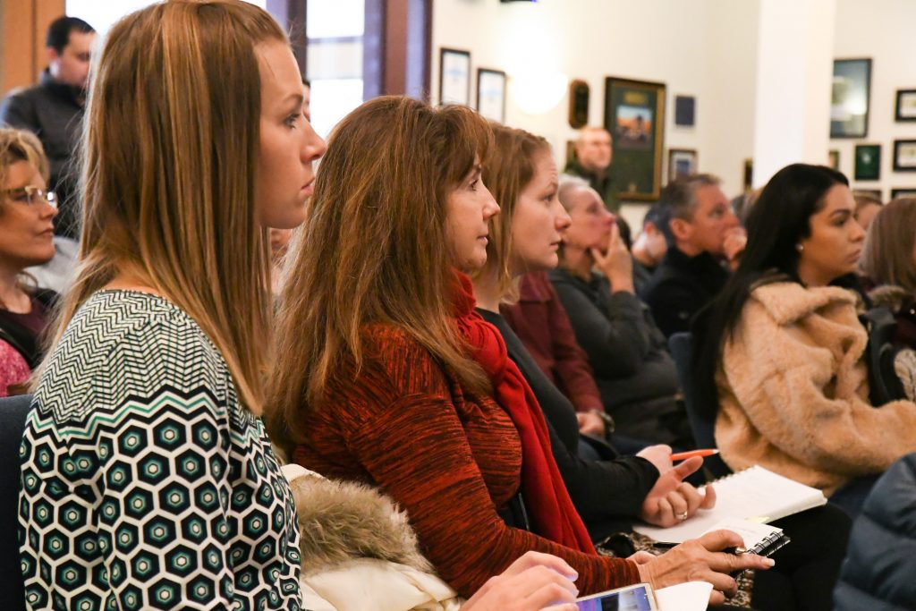 Glenwood Springs Chamber members listen and take notes during the Peak Health presentation at the Garfield County Commisioners building Thursday morning.