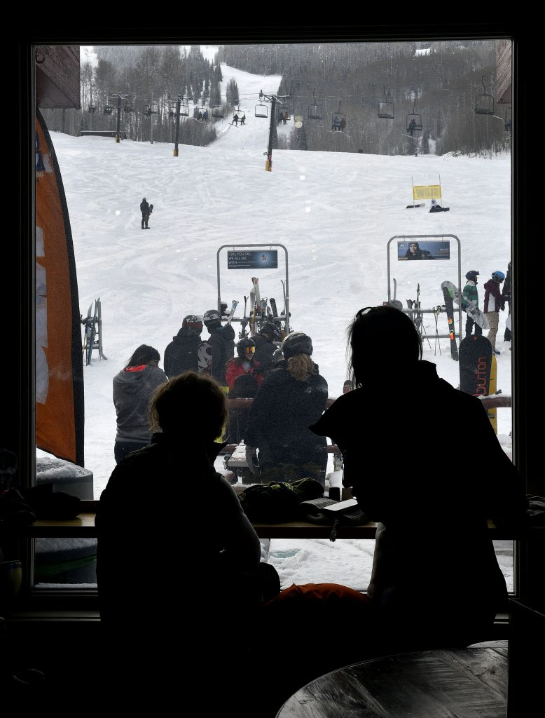 The lodge begins to fill up as people enjoy the view as lunch nears last Friday at Sunlight Mountain.