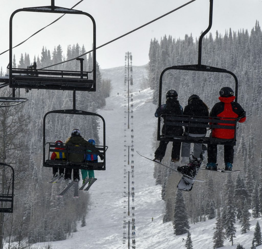 Skiers and riders watch others make their way down Primo as they enjoy the short ride up Tercero last Friday.