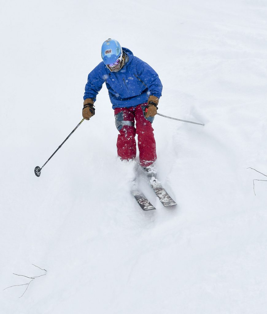 A skier makes some turns in the fresh powder, making his way down Primo last Friday.