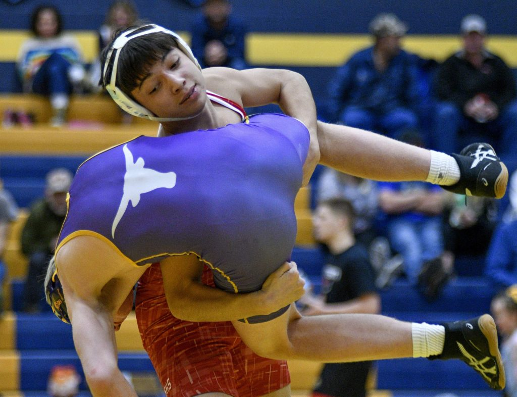 Glenwood's Elo Garcia lifts Basalts' Brady Samuelson during their 170-pound match Saturday during the Rumble in the Rockies at Rifle High School. Garcia won the match on points.