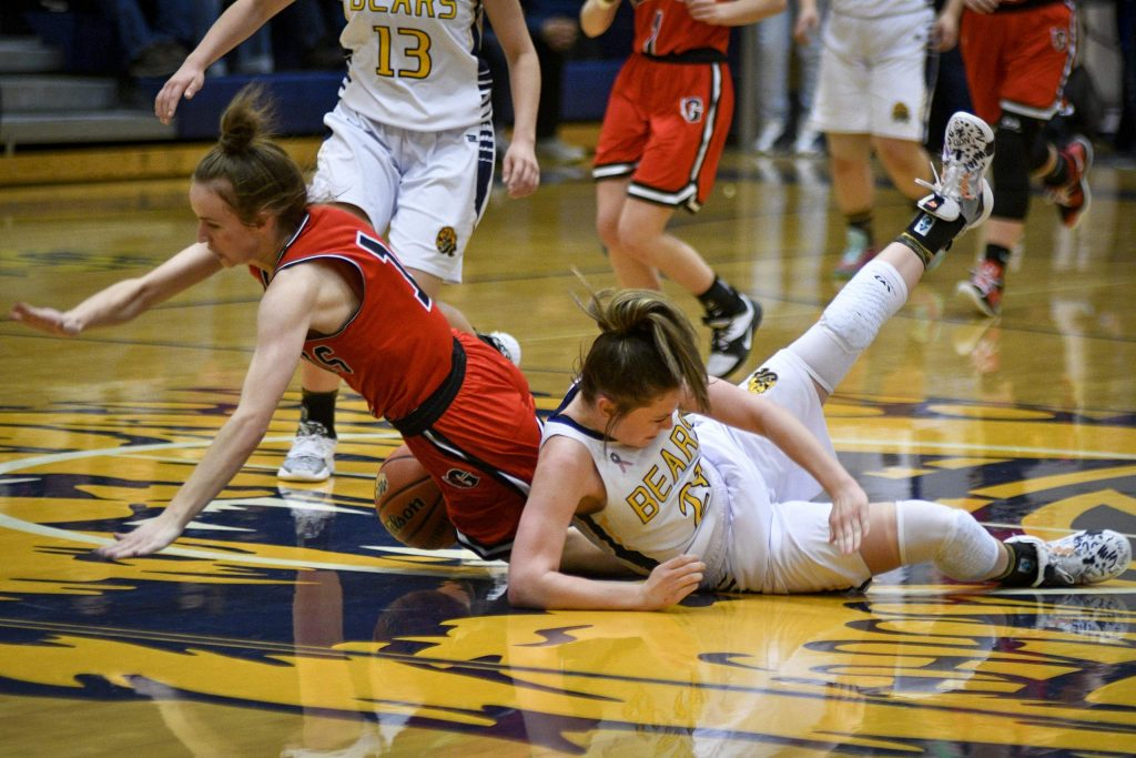 Glenwood's Natalya Taylor collides with Rifle's Jaime Caron as they scramble for the loose ball in the first quarter Friday.