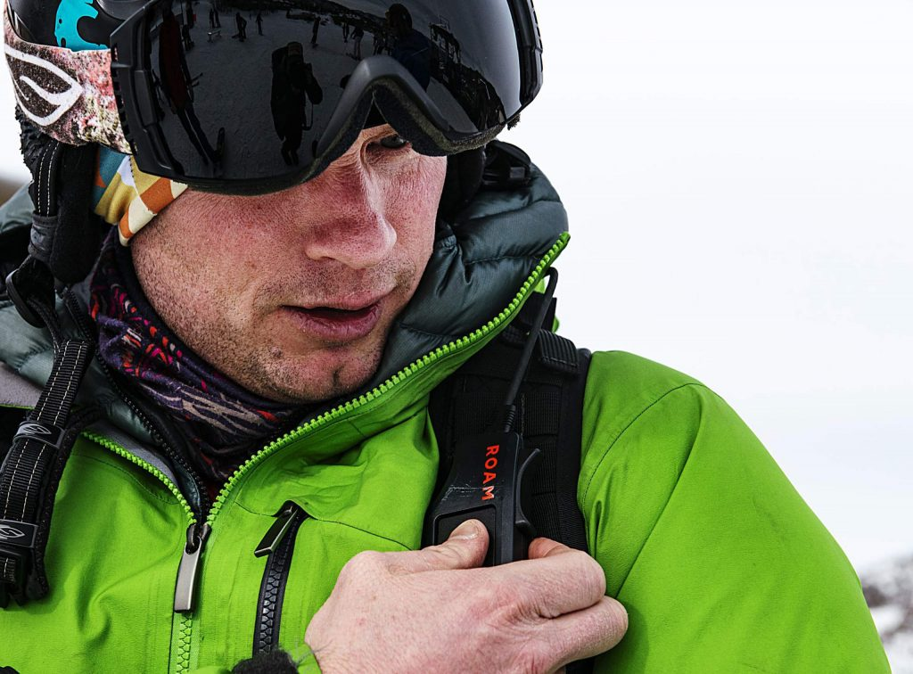 Jim Harris adjusts his ROAM Robotics Elevate exoskeleton using the battery backpack before starting his day of skiing on Snowmass on Friday, Jan. 31, 2020. (Kelsey Brunner/The Aspen Times)