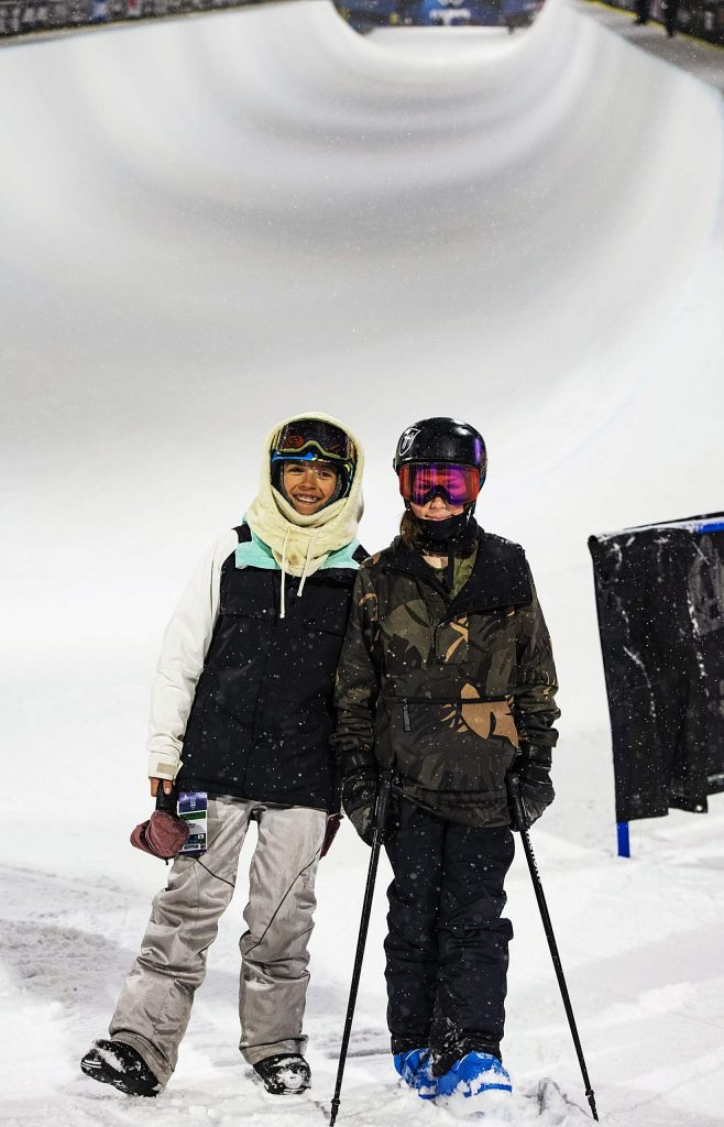 Tabatha Galicia, 14, left, and Hunter Maytin, 12, pose for a portrait at the bottom of the X Games superpipe during practice on Tuesday, Jan. 21, 2020. Both AVSC athletes are forerunning the superpipe for this year's X Games. (Kelsey Brunner/The Aspen Times)